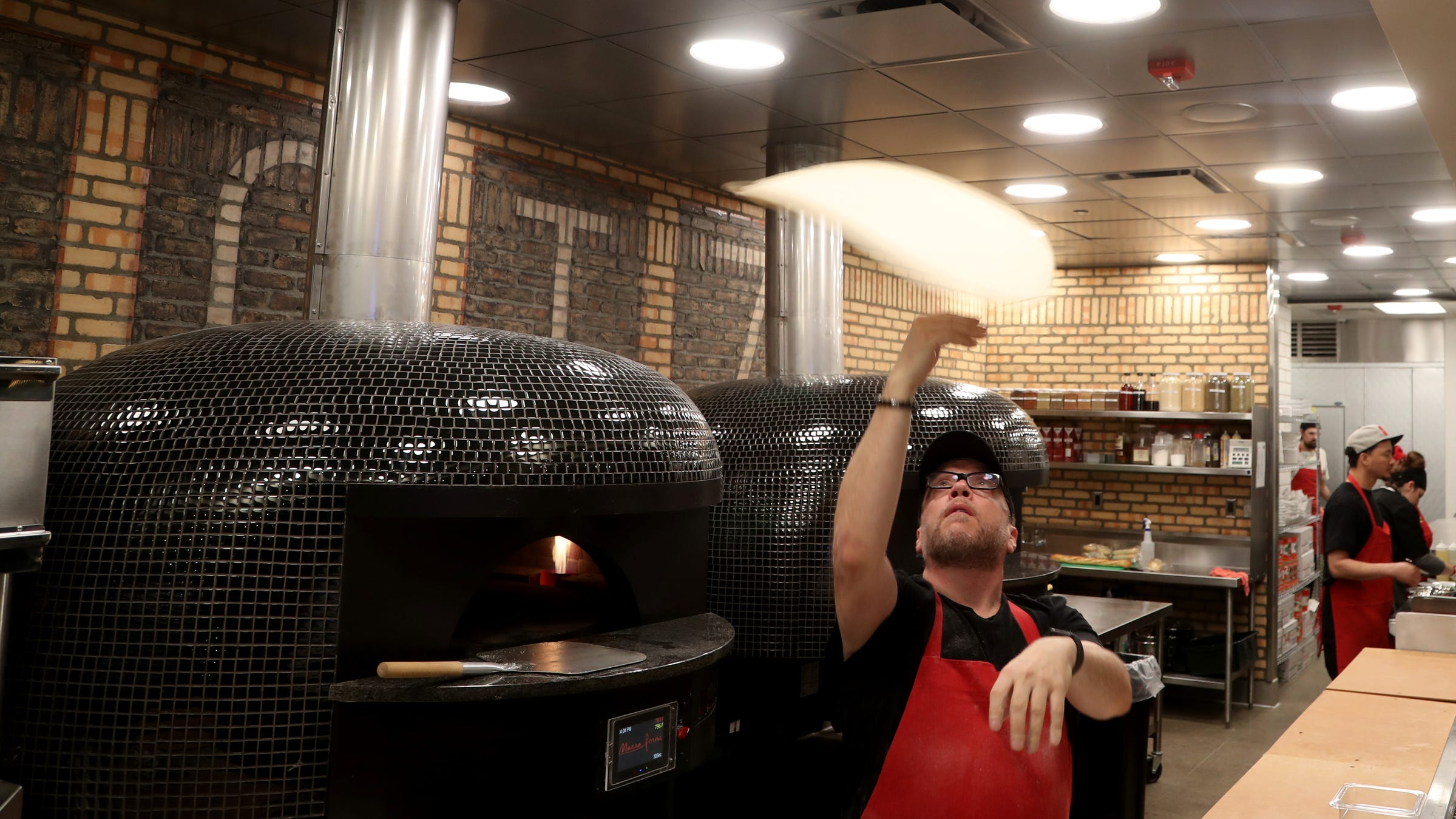Bruno DiFabio, 49, tosses pizza dough in the air to shape it inside Mootz Pizzeria and Bar on Wednesday, January 9, 2019. The new restaurant that serves a variety of classic Italian food and large pizza slices is set to open on January, 28, 2019.