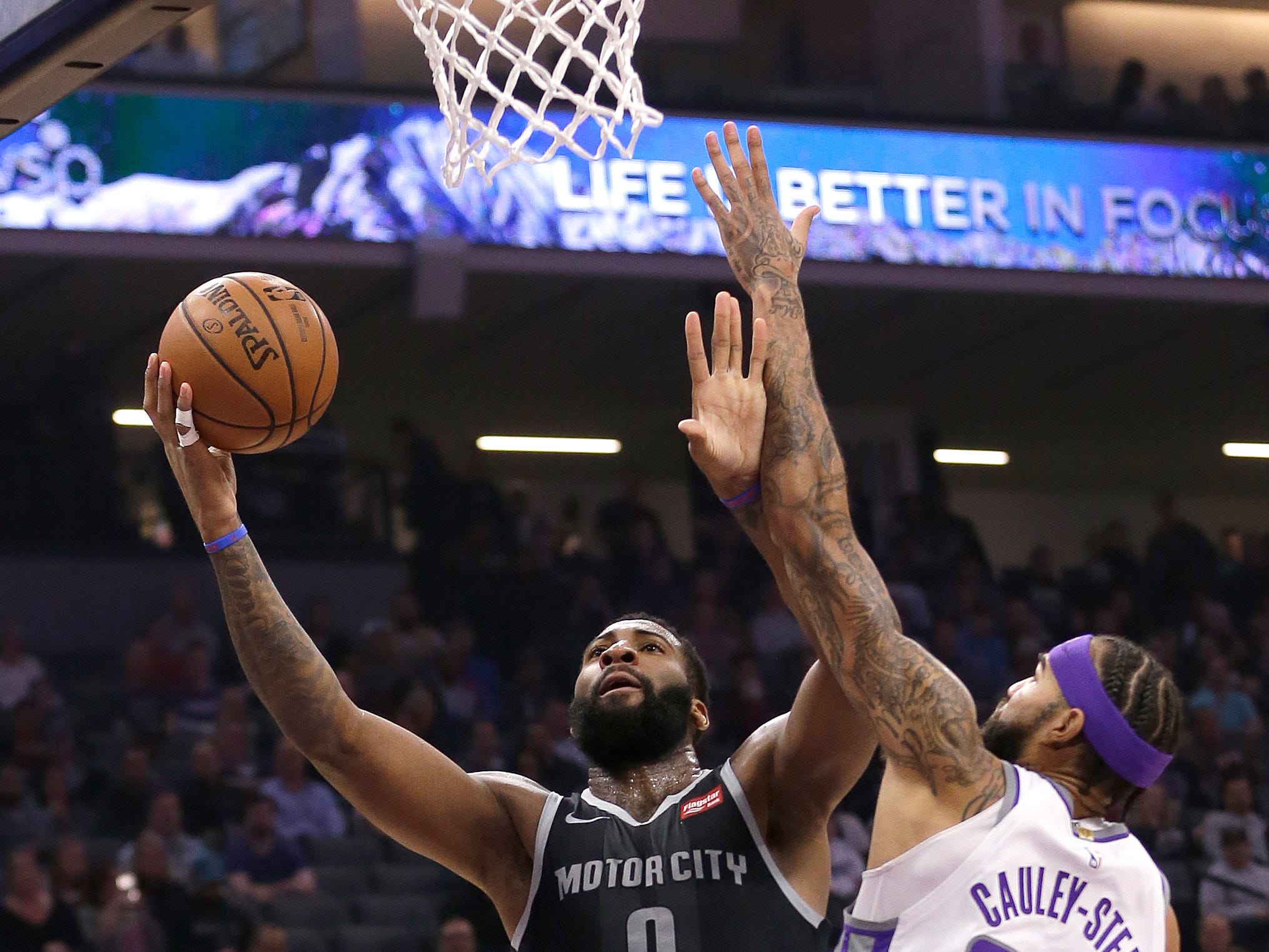 Detroit Pistons center Andre Drummond, left, goes to the basket against Sacramento Kings center Willie Cauley-Stein during the first quarter of an NBA basketball game Thursday, Jan. 10, 2019, in Sacramento, Calif.
