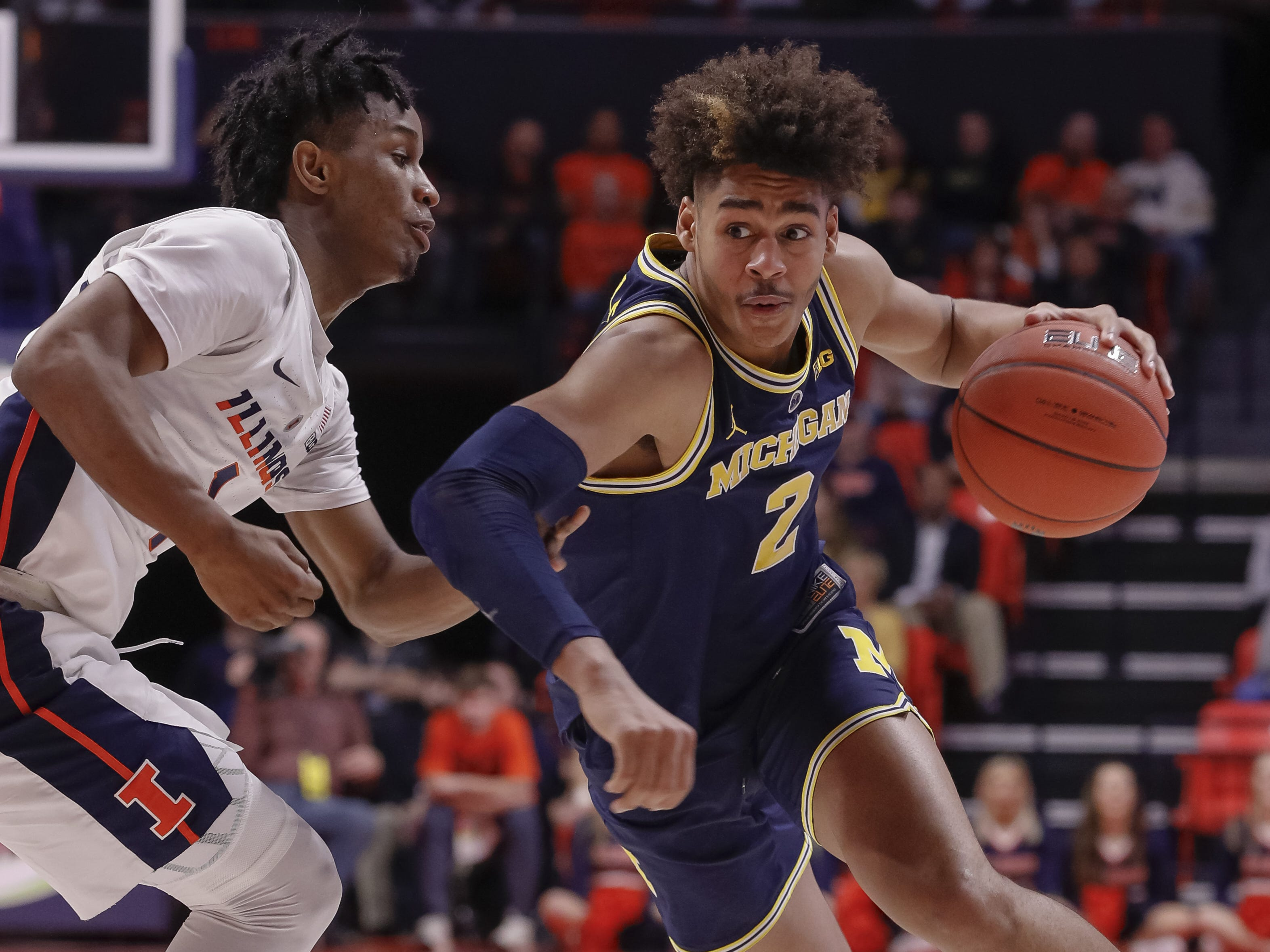 Michigan guard Jordan Poole drives to the basket against Illinois' Trent Frazier during the second half of U-M's 79-69 win on Thursday, Jan. 10, 2019, in Champaign, Ill.