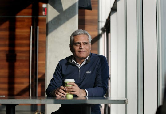 Kumar Galhotra, president of Ford North America, in the cafeteria at Ford World Headquarters in Dearborn.