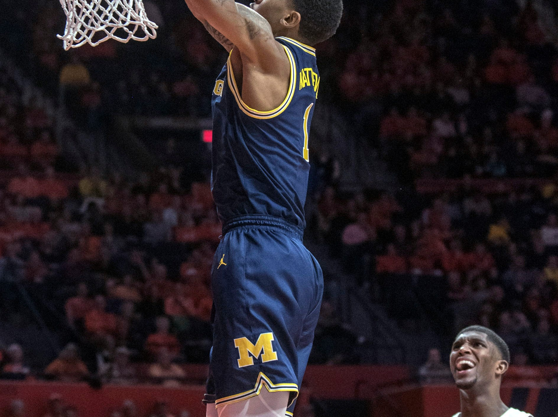 Illinois guard Trent Frazier (1) and Illinois Kipper Nichols (2) watch as Michigan guard Charles Matthews (1) dunks during the second half.