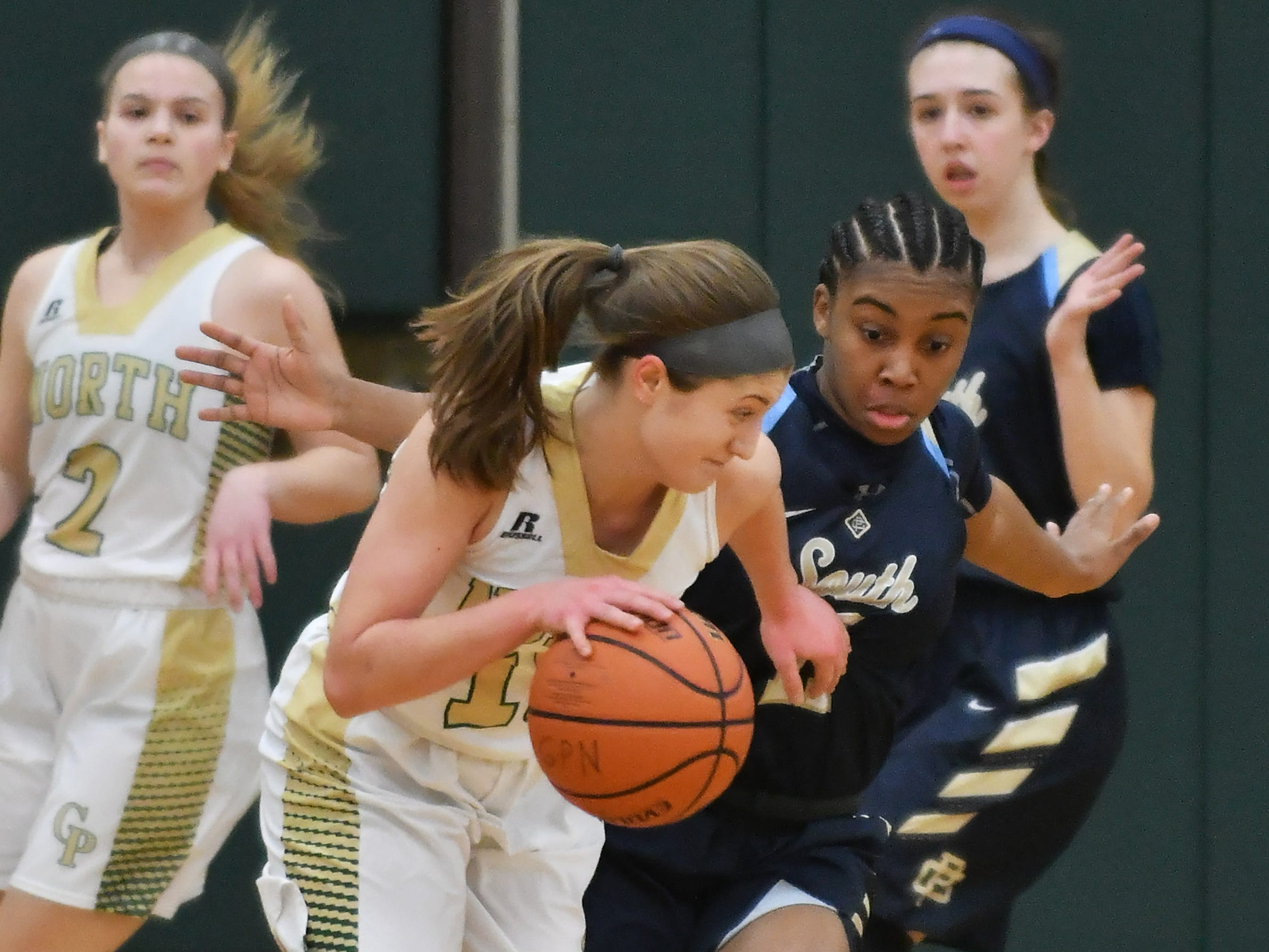 Grosse Pointe South's Sydni Hall, right, guards Grosse Pointe North's Evelyn Zacharias  in the first quarter.