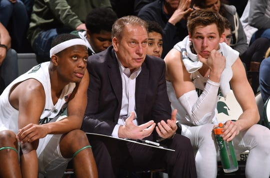 Cassius Winston, left, with coach Tom Izzo and Matt McQuaid says any team in the Big Ten can be beaten on any given night.