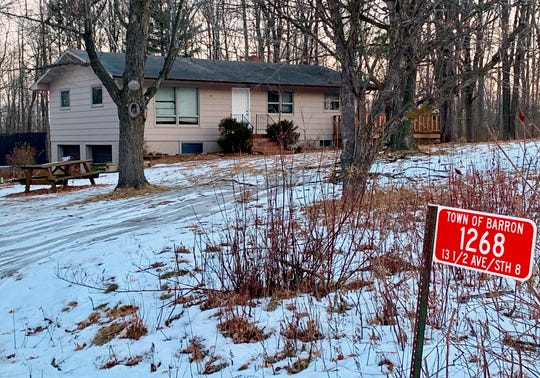 The home where teenager Jayme Closs lived with her parents is seen Friday in Barron, Wis.