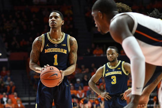 Michigan guard Charles Matthews (1) shoots a free throw Thursday night against Illinois.