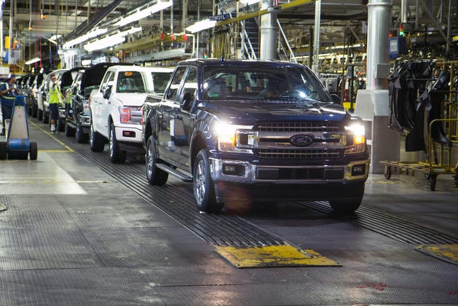 A Ford F-150 truck rolls off the line at Dearborn Truck Plant.
