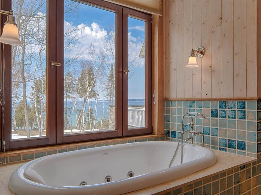 Not only does it overlook Lake Michigan, it has a steam room, a billiards room, a wine room and a 1,417-square-foot guest house.