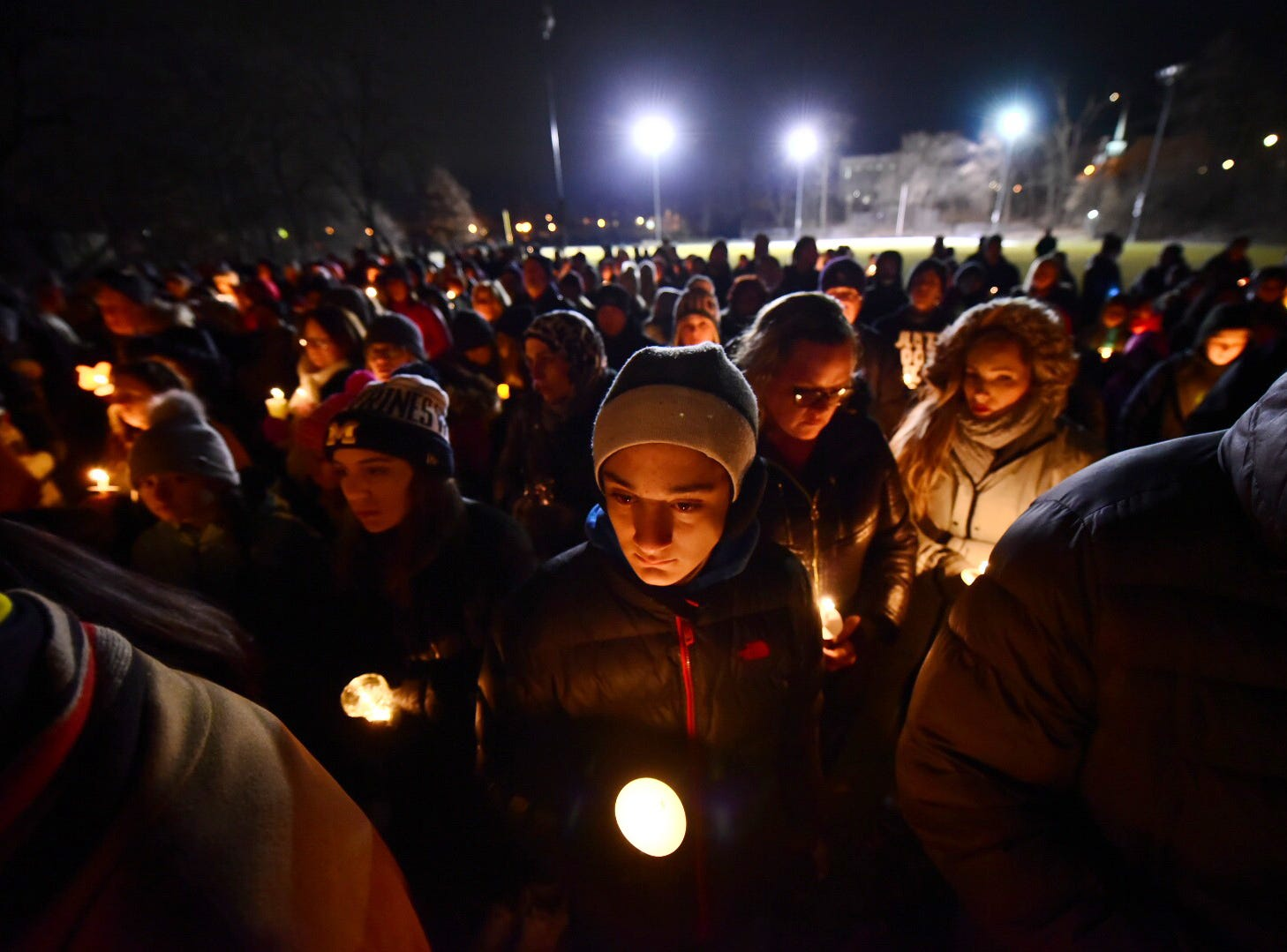 Community members brave the cold Friday evening at Ford Field Park in Northville to pay their respects at a candlelight vigil in memory of the Abbas Family -- Issam, Rima and their three children Ali, 14, Isabelle, 13 and Giselle, 7,--  who all were tragically killed in a wrong-way driver traffic accident in Kentucky last Sunday while returning from a Family vacation. Photos taken on January 11, 2019.