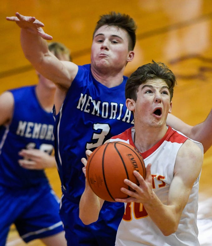 Mater Dei's Zach Schoenstein (30) shoots past Memorial's Branson Combs (3) as the Memorial Tigers play the Mater Dei Wildcats in the Southern Indiana Athletic Conference semi-finals at Central High Thursday, January 10, 2019.