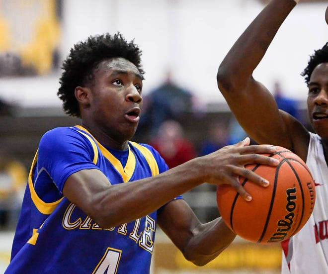 Isaiah Swope (4) scored the first 14 points of the final period to lift Castle past Southridge on Saturday in the River City Classic.