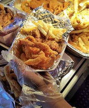 Divas Cookin's best seller--the fish strips and chicken wing combo with fries.