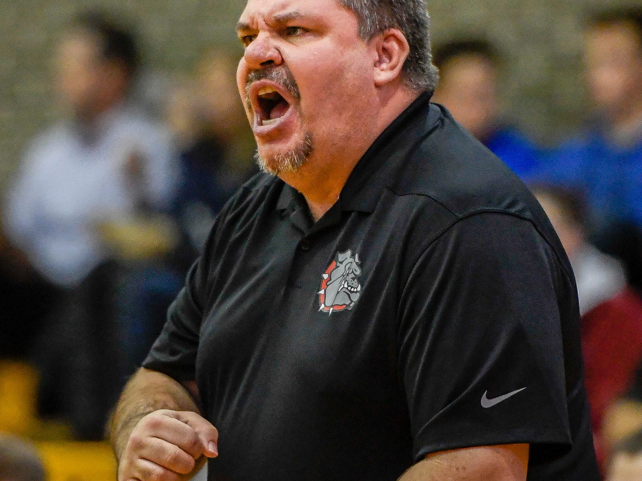 Bosse head coach Shane Burkhart reacts to play on the court as the Castle Knights play the Bosse Bulldogs in the Southern Indiana Athletic Conference semi-finals at Central High Thursday, January 10, 2019.
