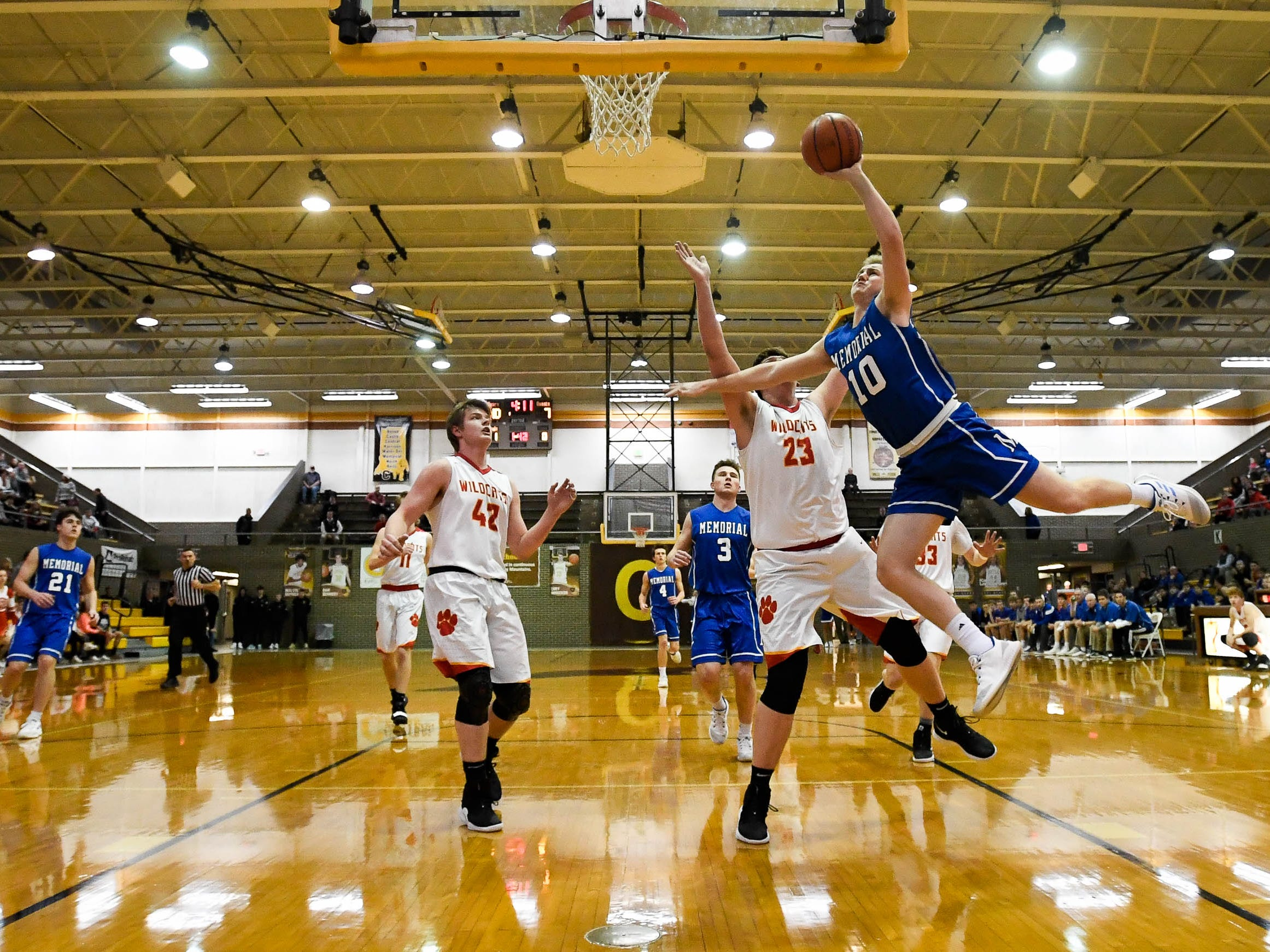 Memorial's Michael Lindauer (10) goes up for a lay-up as the Memorial Tigers play the Mater Dei Wildcats in the Southern Indiana Athletic Conference semi-finals at Central High Thursday, January 10, 2019.