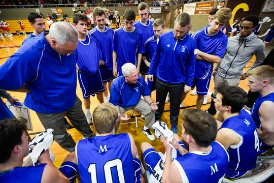 Memorial Head Coach Rick Wilgus talks to his team during a time out as the Memorial Tigers play the Mater Dei Wildcats in the Southern Indiana Athletic Conference semi-finals at Central High Thursday, January 10, 2019.