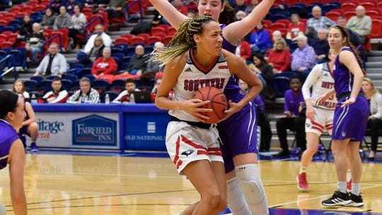 Imani Guy drives to the basket during the University of Southern Indiana women's 83-72 loss to Truman State.