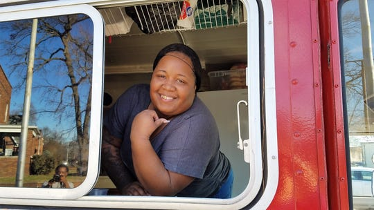 LaTonya Davis in the Divas Cookin truck, bringing you crispy fish, chicken and loaded fries.