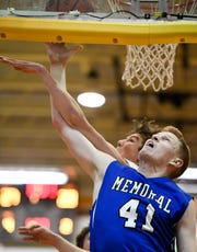 Memorial's Sam DeVault (41) is fouled by Mater Dei's Zach Schoenstein (30) as the Memorial Tigers play the Mater Dei Wildcats in the Southern Indiana Athletic Conference semi-finals at Central High Thursday, January 10, 2019.