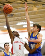 Bosse's Ty'ran Funches (1) shoots over Castle's Bob Nunge (20) as the Castle Knights play the Bosse Bulldogs in the Southern Indiana Athletic Conference semi-finals at Central High Thursday, January 10, 2019.