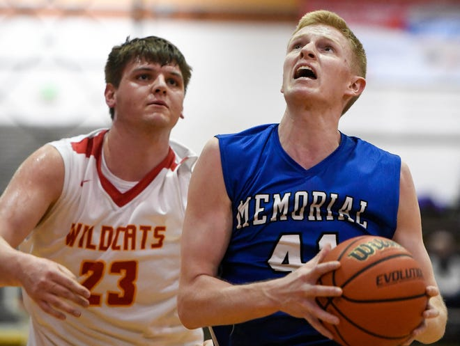 Eying the basket, Memorial's Sam DeVault (41) drives past Mater Dei's Logan Carter (23) as the Memorial Tigers play the Mater Dei Wildcats in the Southern Indiana Athletic Conference semi-finals at Central High Thursday, January 10, 2019.