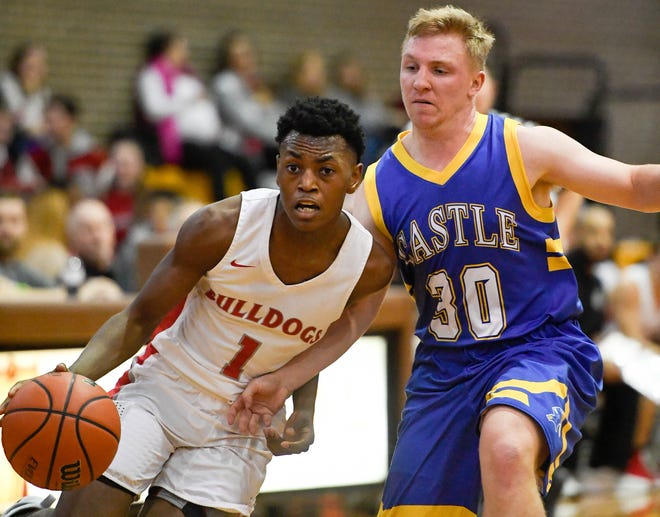 Bosse's Ty'ran Funches (1) drives against Castle's Brycen Moore (30) as the Castle Knights play the Bosse Bulldogs in the Southern Indiana Athletic Conference semi-finals at Central High Thursday, January 10, 2019.