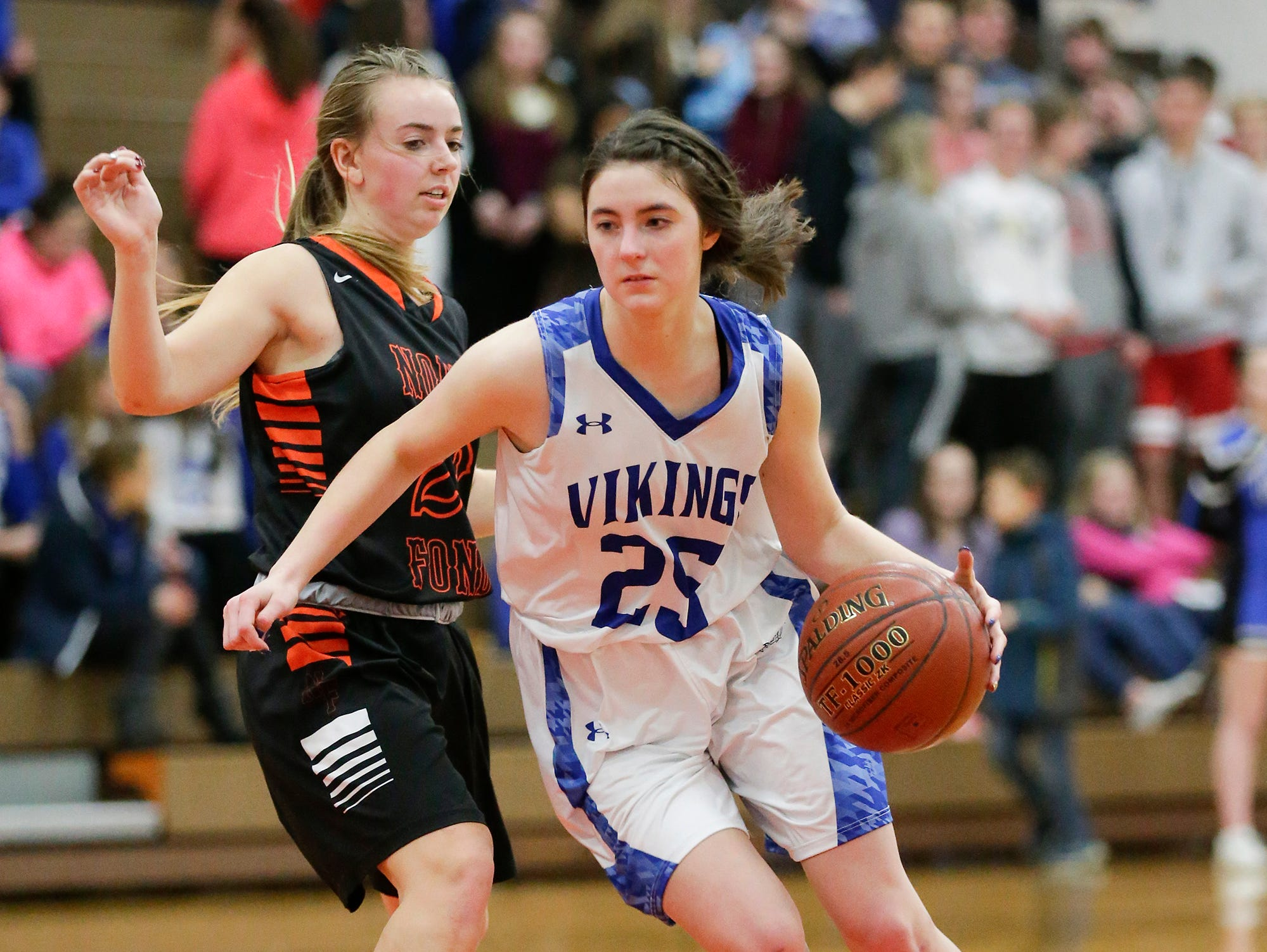 Winnebago Lutheran Academy girls basketball's Geneva Hewitt makes her way past North Fond du Lac High School's Jordyn Stattbacher January 10, 2019 during their game in Fond du Lac. Doug Raflik/USA TODAY NETWORK-Wisconsin