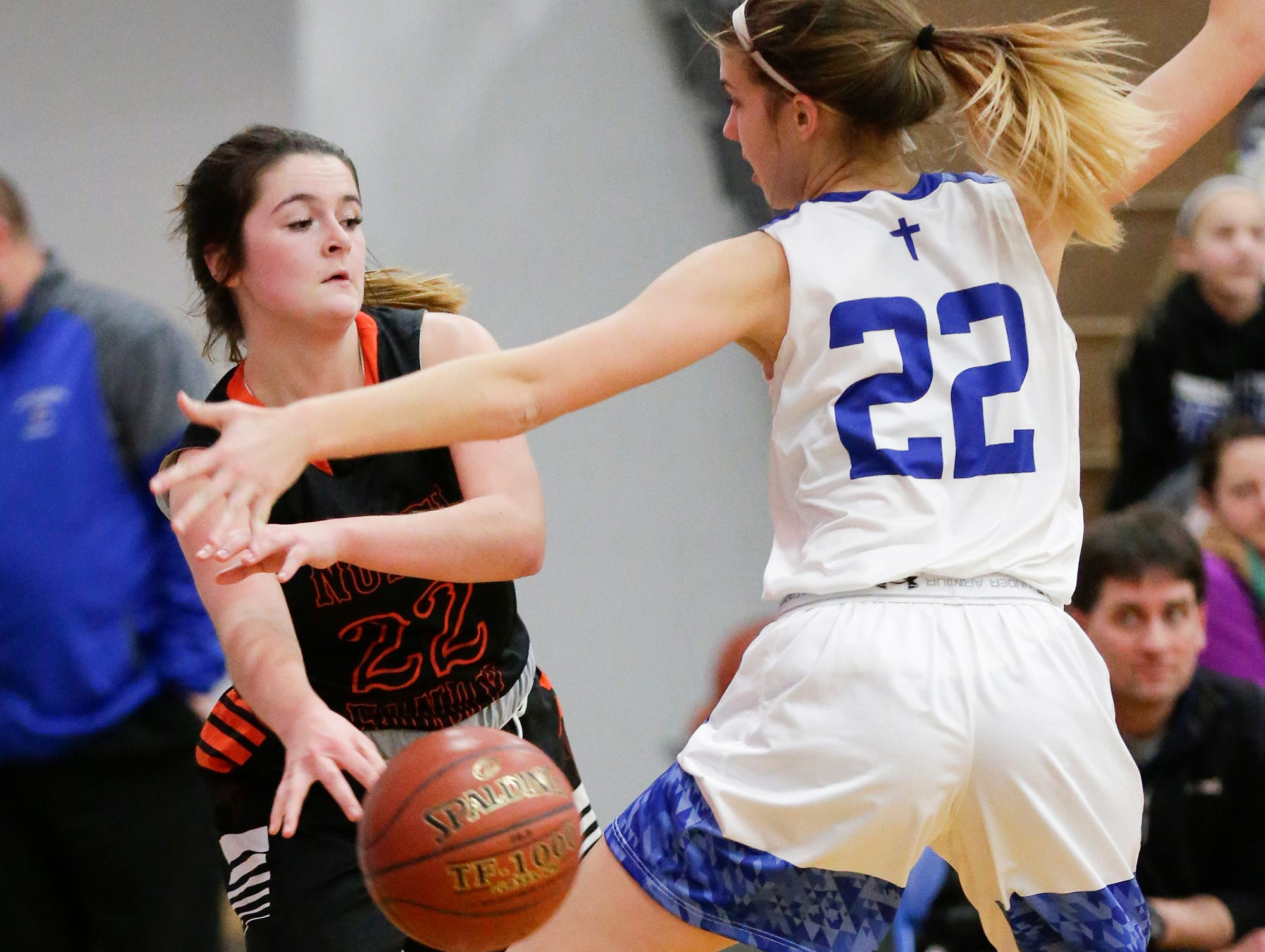 North Fond du Lac High School girls basketball's Lilly Sadoff passes the ball past Winnebago Lutheran Academy's Kaylee Frey January 10, 2019 during their game in Fond du Lac. Doug Raflik/USA TODAY NETWORK-Wisconsin