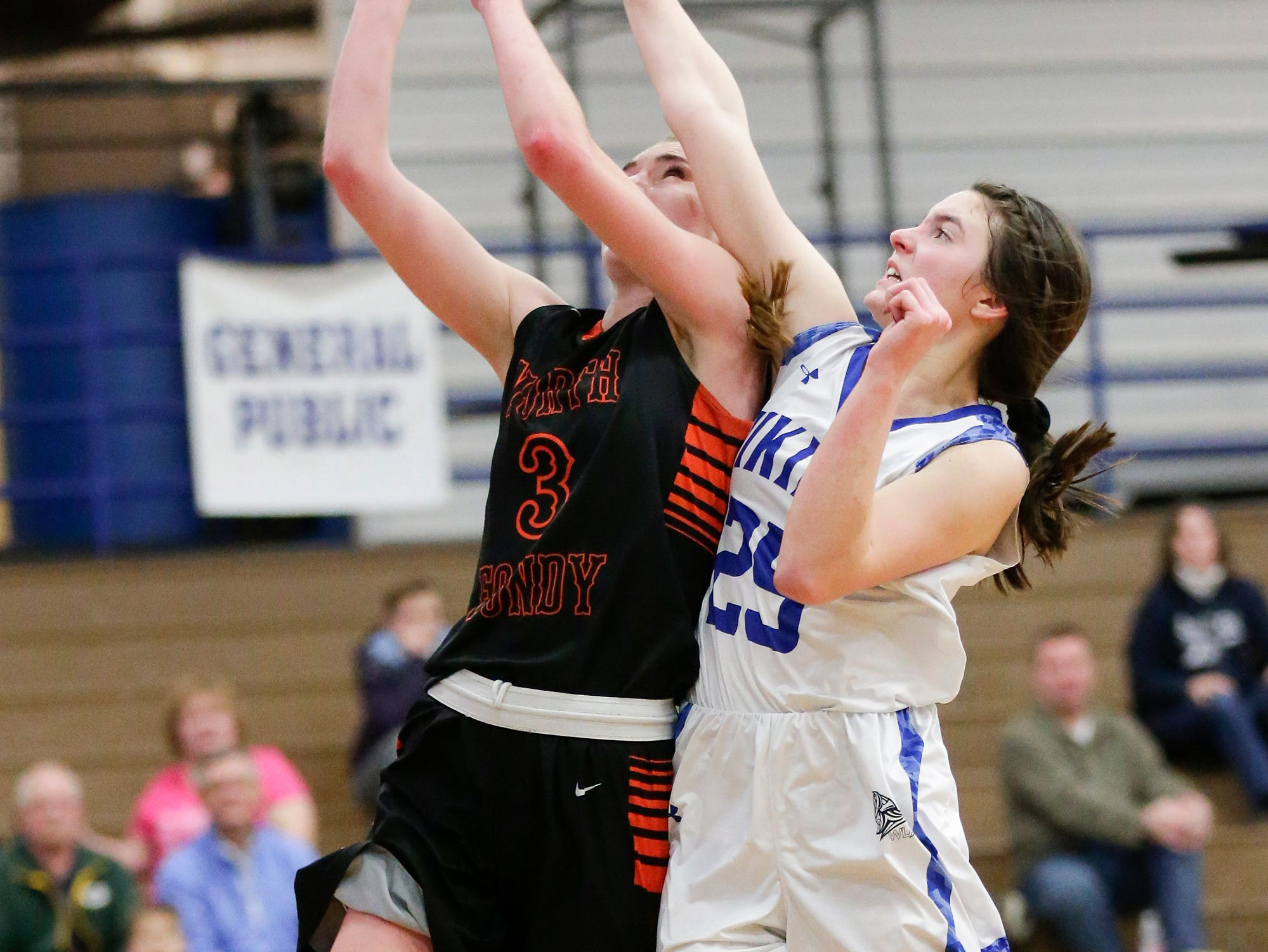 North Fond du Lac High School girls basketball's Rebecca Kingsland makes this basket despite being fouled by Winnebago Lutheran Academy's Geneva Hewitt January 10, 2019 during their game in Fond du Lac. Doug Raflik/USA TODAY NETWORK-Wisconsin