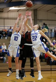 Winnebago Lutheran's Kalli Wiechman (10) and Kaylee Frey (22) go for a rebound with North Fond du Lac High School's Rebecca Kingsland on Thursday in Fond du Lac.