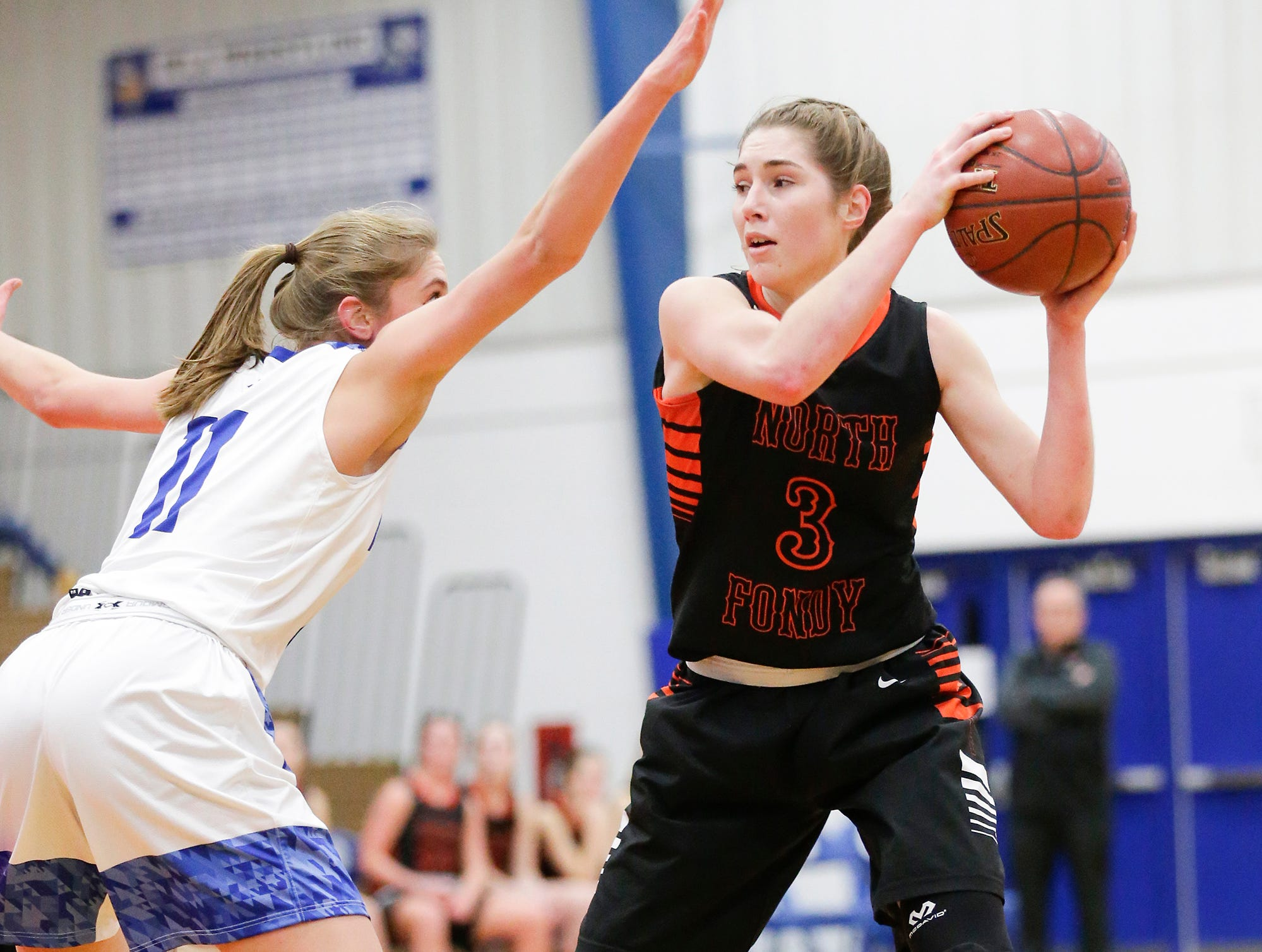North Fond du Lac High School girls basketball's Rebecca Kingsland looks to pass the ball against Winnebago Lutheran Academy's Alyssa Lorenz January 10, 2019 during their game in Fond du Lac. Doug Raflik/USA TODAY NETWORK-Wisconsin