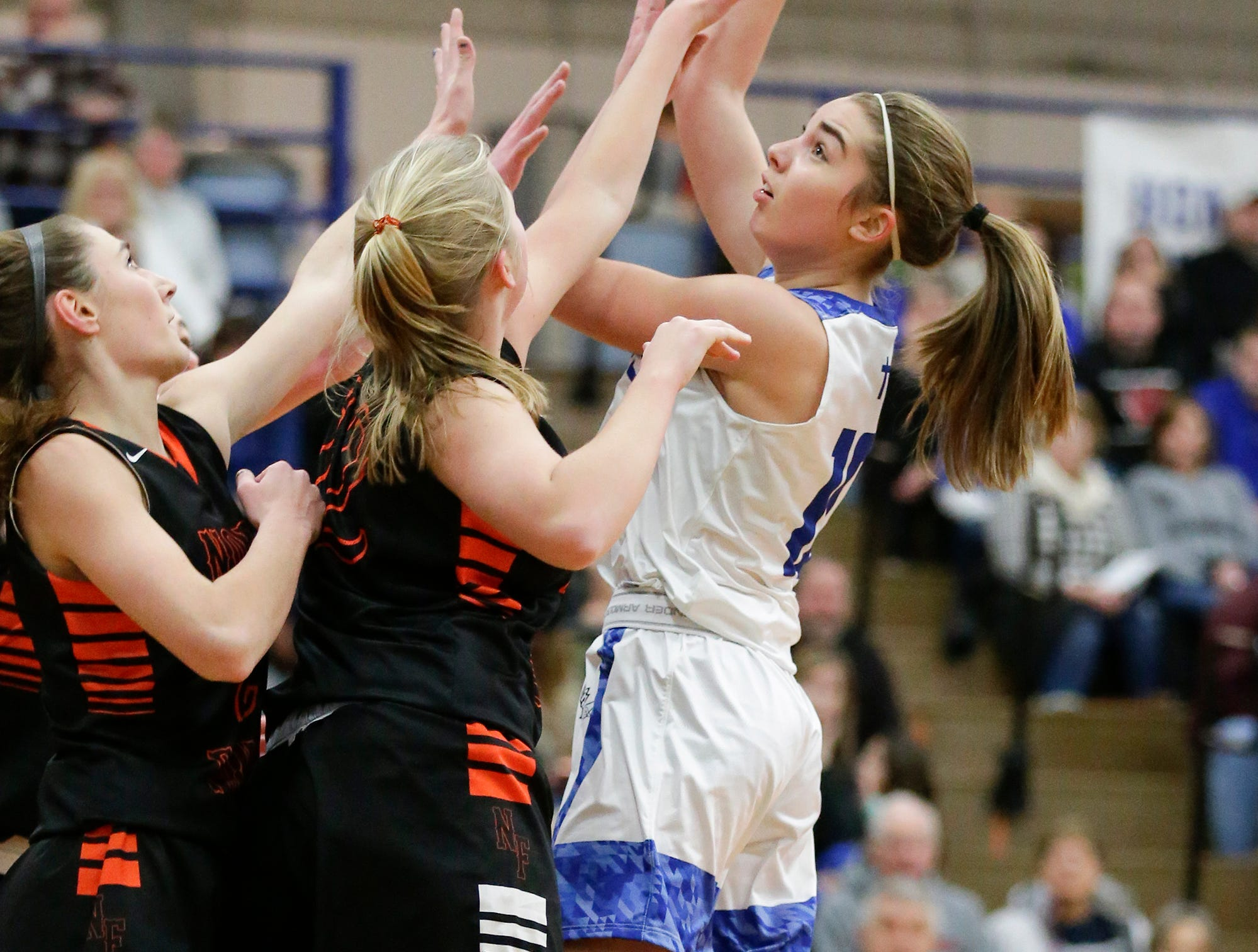 Winnebago Lutheran Academy girls basketball's  Kalli Wiechman goes up for a shot against North Fond du Lac High School January 10, 2019 during their game in Fond du Lac. Doug Raflik/USA TODAY NETWORK-Wisconsin