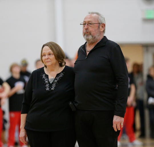 Jim Koopmans of Cambria (right) is introduced Jan. 3, 2019, with his wife, Arlyss, as the Cambria-Friesland High School recipient of the Hoops for Hope cancer charity event, which took place during halftime of the CWC and Cambria-Friesland High School boys basketball game in Waupun.