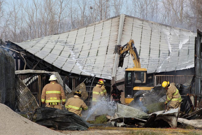 Fire crews work to quell a barn fire that killed two ponies at 5000 County Road 79.