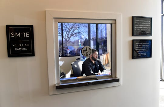 The first window patients and caregivers see at The Forest Sandusky medical marijuana dispensary.