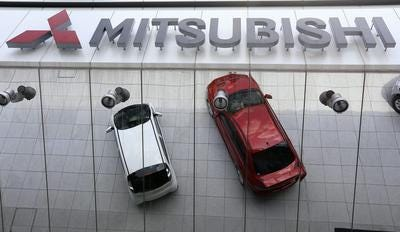 A 2014 file photo shows Mitsubishi Motors Corp.'s vehicles displayed outside its headquarters in Tokyo, Japan. The Fort Collins Mitsubishi store will close Feb. 8.