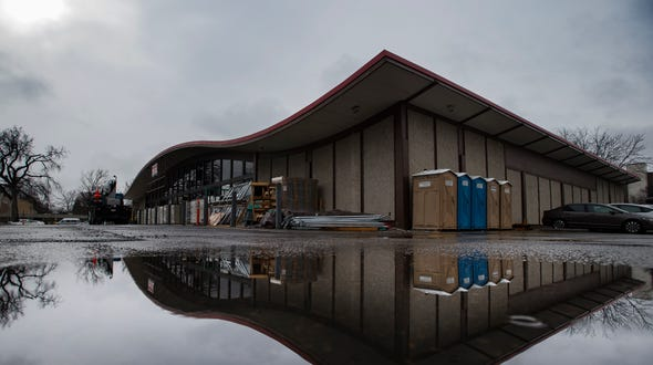Construction continues through the rain at the future site of Lucky's Market on Friday, Jan. 11, 2019, at the intersection of South College Avenue and West Mulberry Street in Fort Collins, Colo.