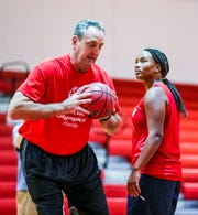 Former NBA player Brad Branson, 60, a 1976 North Fort Myers High School graduate, has returned home to support his former community. He teaches at North and is a girls basketball team assistant coach. He works here with Erica Clare.