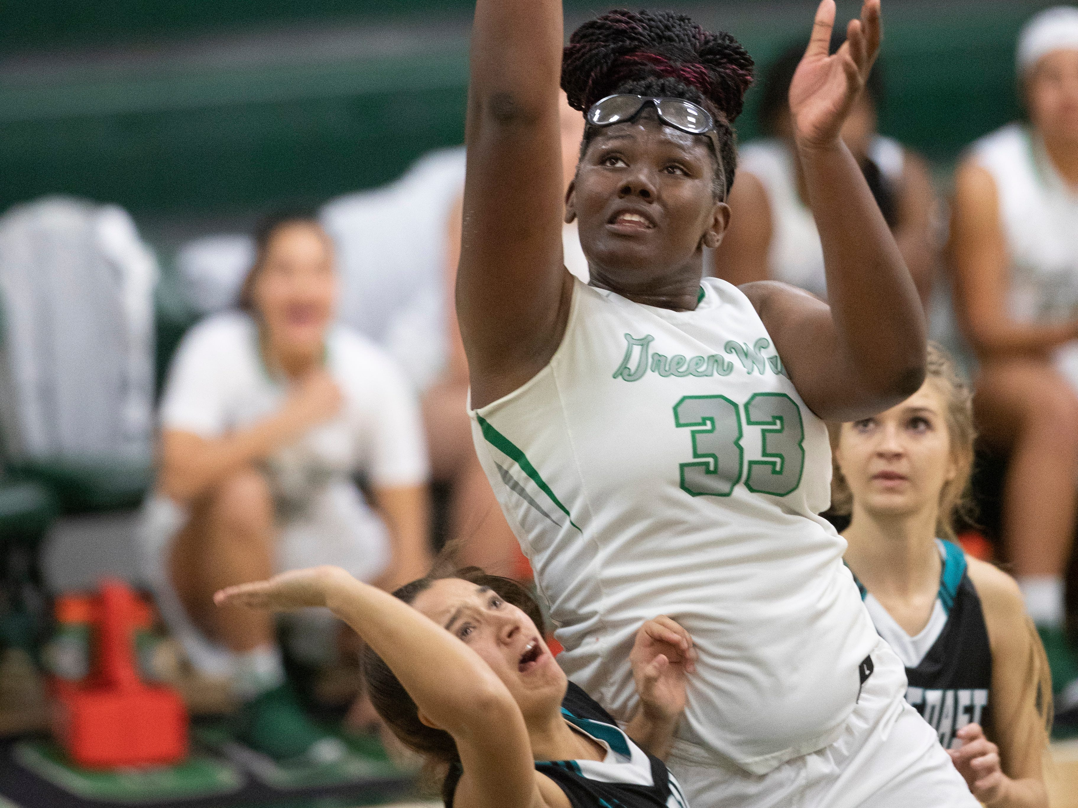 Fort Myers High School's Chaniya Clark scores against Gulf Coast on Thursday in Fort Myers. Gulf Coast beat Fort Myers 71-67.