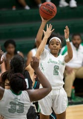 Fort Myers High School's Janay Outten passes against Gulf Coast recently in Fort Myers. Gulf Coast beat Fort Myers 71-67.