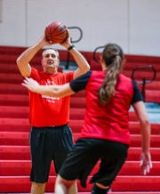 Former NBA player Brad Branson, 60, a 1976 North Fort Myers High School graduate, has returned home to support his former community. He teaches at North and is a girls basketball team assistant coach. He works here with Rece Morgan.