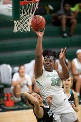 Fort Myers High School's Chaniya Clark scores against Gulf Coast recently in Fort Myers. Gulf Coast beat Fort Myers 71-67.