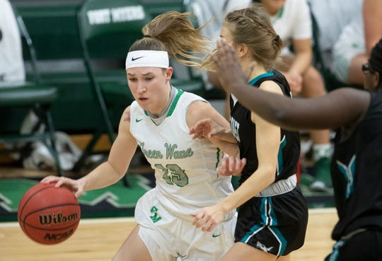 Fort Myers High School's Tatum Hayes drives to the basket against Gulf Coast recently in Fort Myers. Gulf Coast beat Fort Myers 71-67.