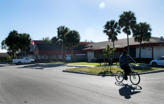 A bicyclist rides through the parking lot of the STARS Complex in Fort Myers on Friday, January 11, 2019.