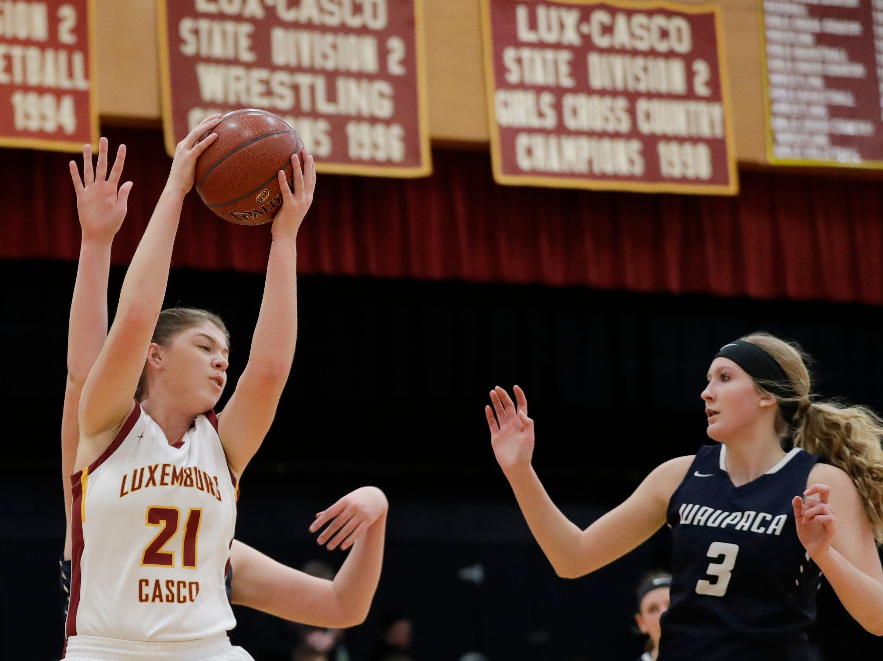 Luxemburg-Casco's Paige Skubal (21) grabs a rebound against Waupaca's Kalyn Klug (3) in a girls basketball game at Luxemburg-Casco high school on Thursday, January 10, 2019 in Luxemburg, Wis.