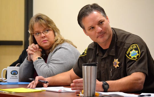 New Oconto County Sheriff Todd Skarban listens during the Law Enforcement/Judiciary Committee meeting on Jan. 9. Jail administrator Carol Kopp is at left.  The panel's meeting was the first as sheriff for Skarban, whose said after five days the experience has been energizing.