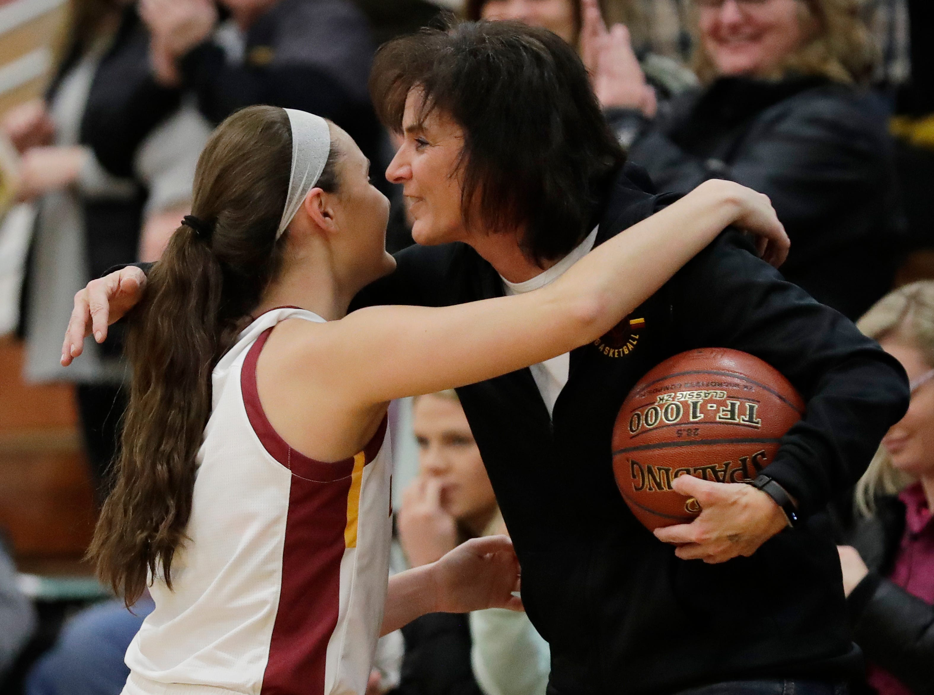Luxemburg-Casco's Cassie Schiltz (3) hugs her mom after breaking the school's all-time scoring record with her 1679th point in a girls basketball game against Waupaca at Luxemburg-Casco high school on Thursday, January 10, 2019 in Luxemburg, Wis. The record was previously set at 1678 by Rachel Porath in 2004.