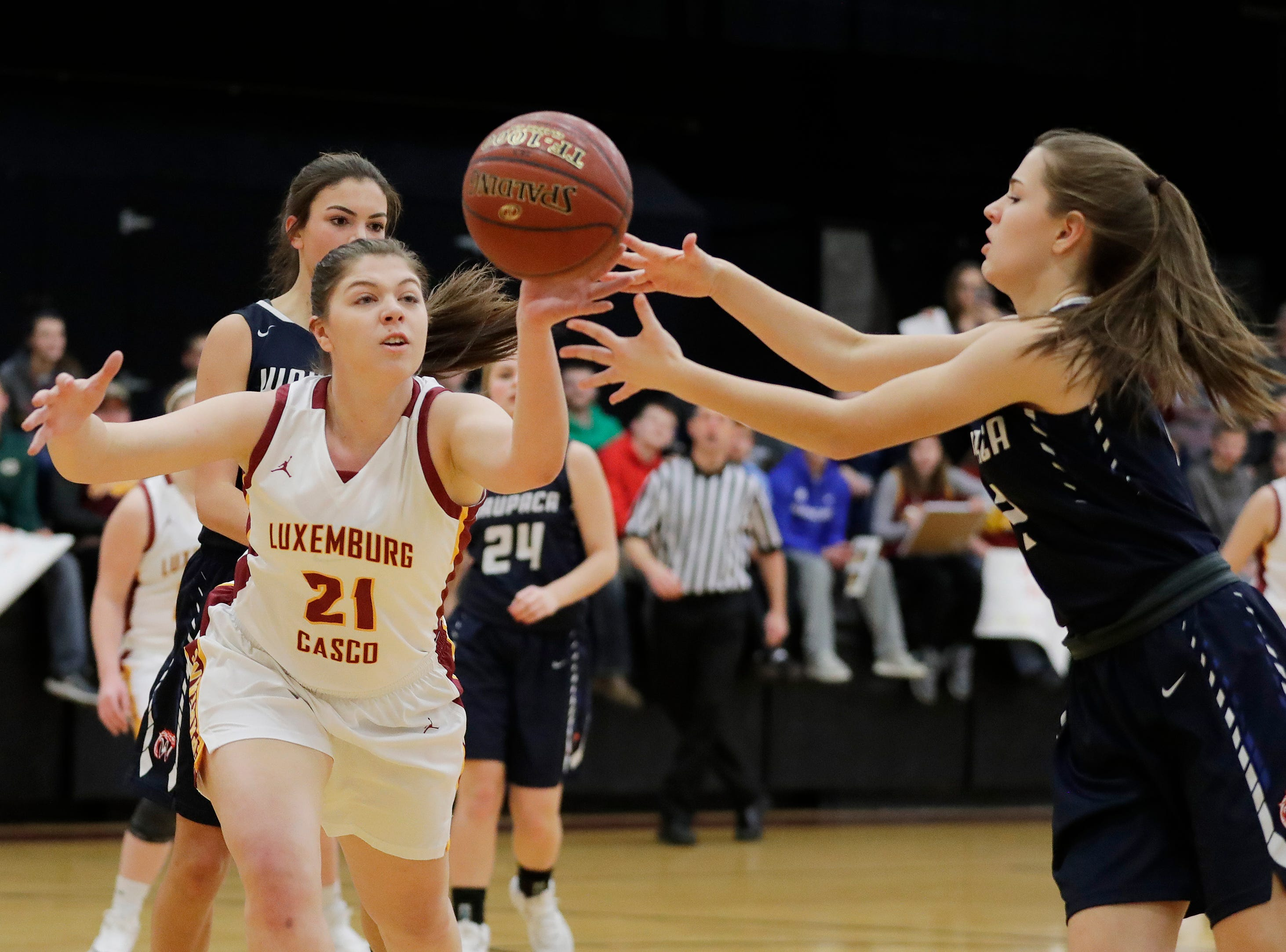 Luxemburg-Casco's Paige Skubal (21) goes for a rebound against Waupaca's Ella Snyder (2) in a girls basketball game at Luxemburg-Casco high school on Thursday, January 10, 2019 in Luxemburg, Wis.