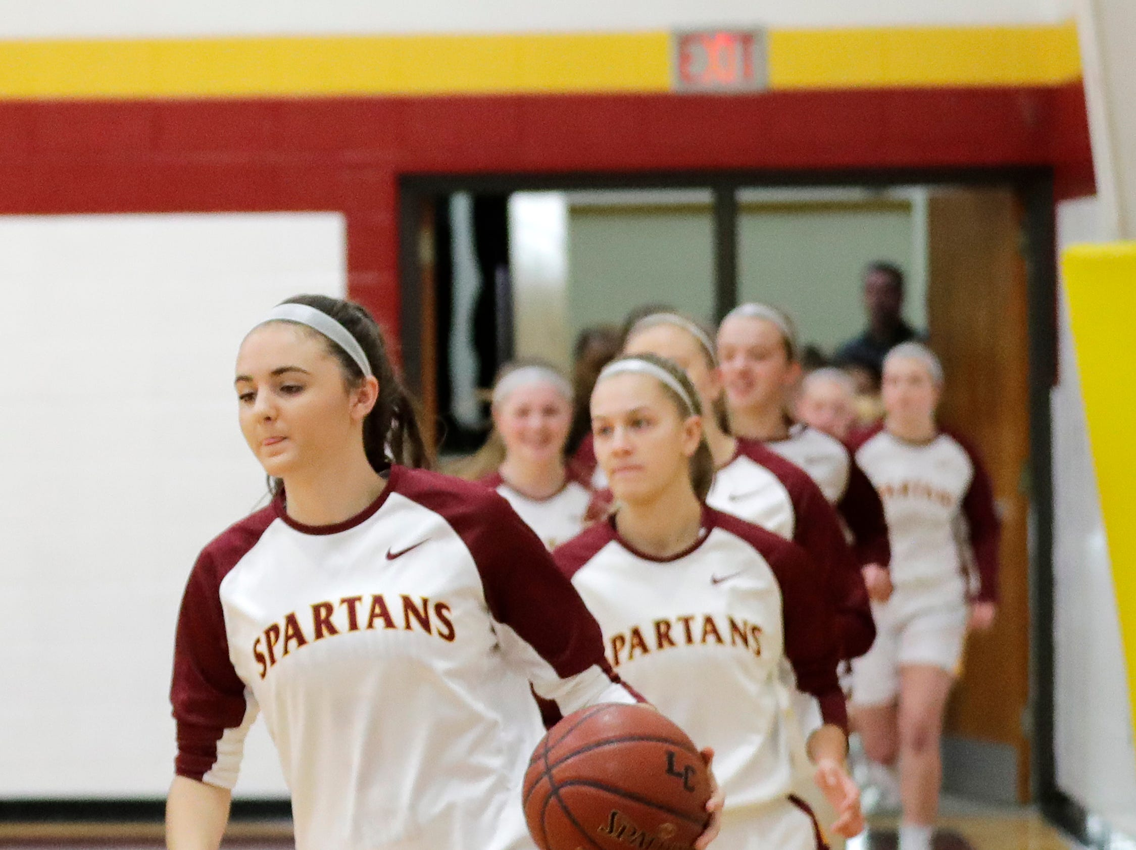 Luxemburg-Casco's Cassie Schiltz (3) leads the Spartans out to face Waupaca in a girls basketball game at Luxemburg-Casco high school on Thursday, January 10, 2019 in Luxemburg, Wis.