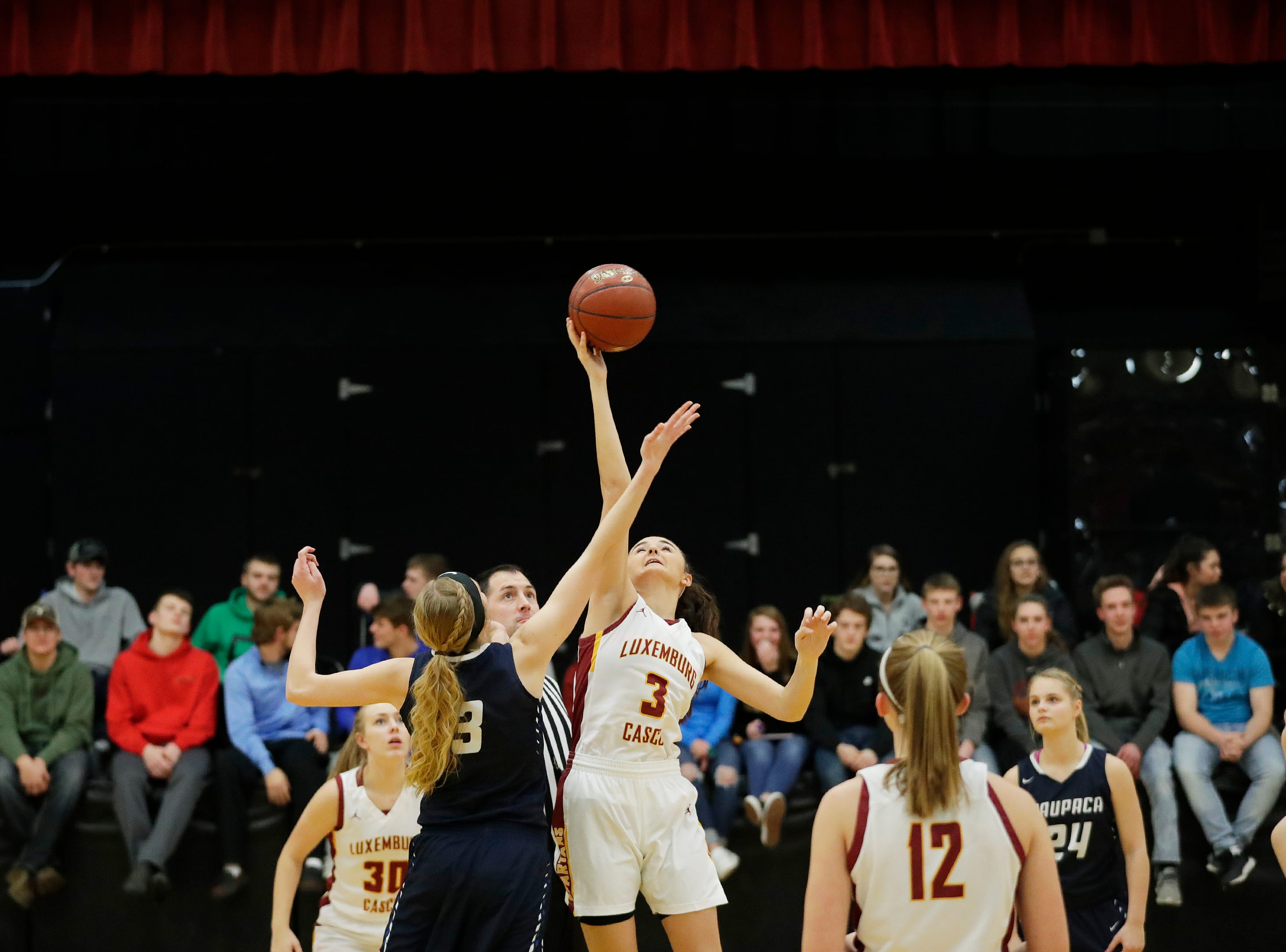 Luxemburg-Casco's Cassie Schiltz (3) wins the opening tipoff against Waupaca in a girls basketball game at Luxemburg-Casco high school on Thursday, January 10, 2019 in Luxemburg, Wis.