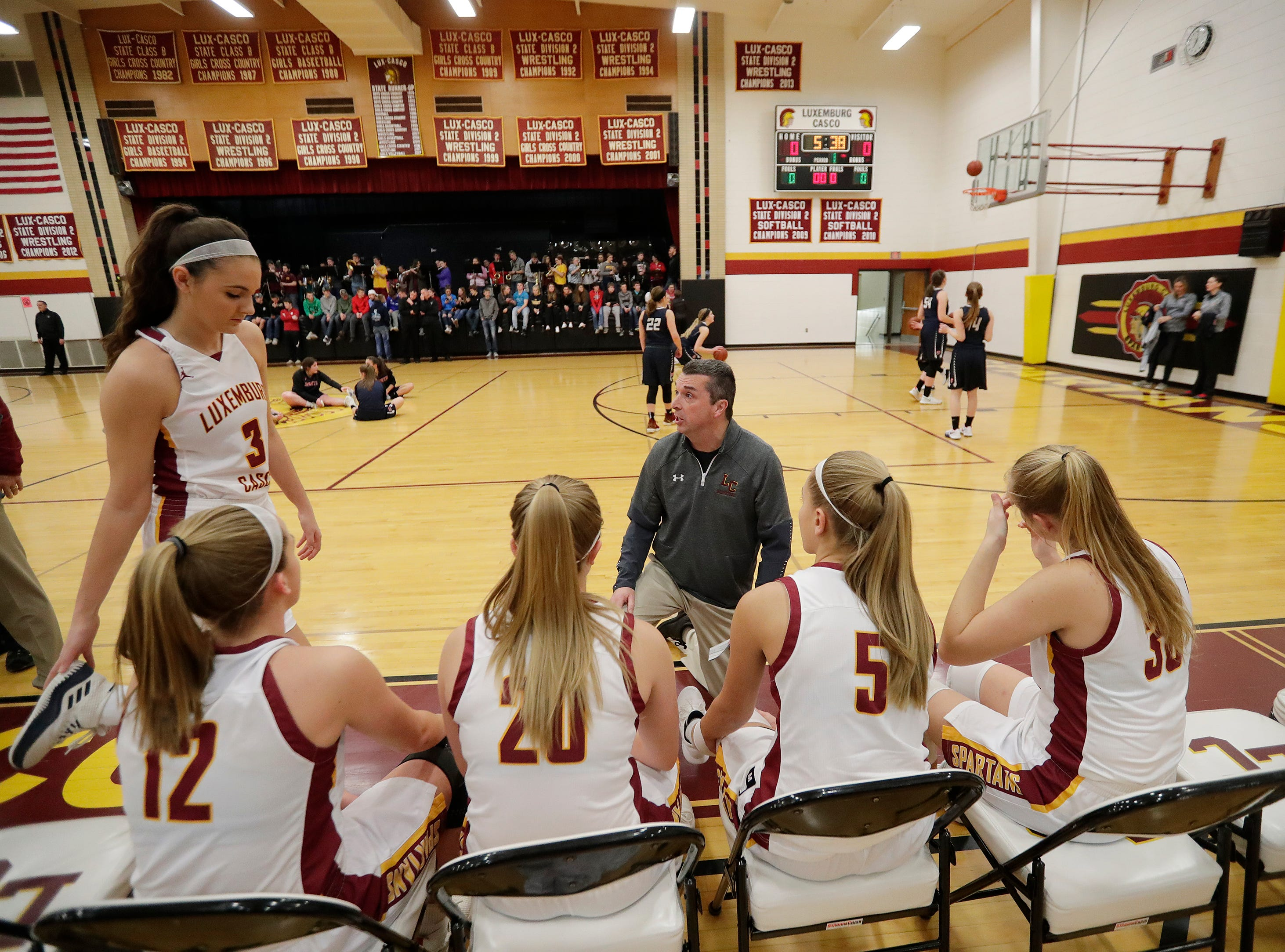 Luxemburg-Casco head coach Jeff Jodar talks to Cassie Schiltz (3) before a game against Waupaca at Luxemburg-Casco high school on Thursday, January 10, 2019 in Luxemburg, Wis.