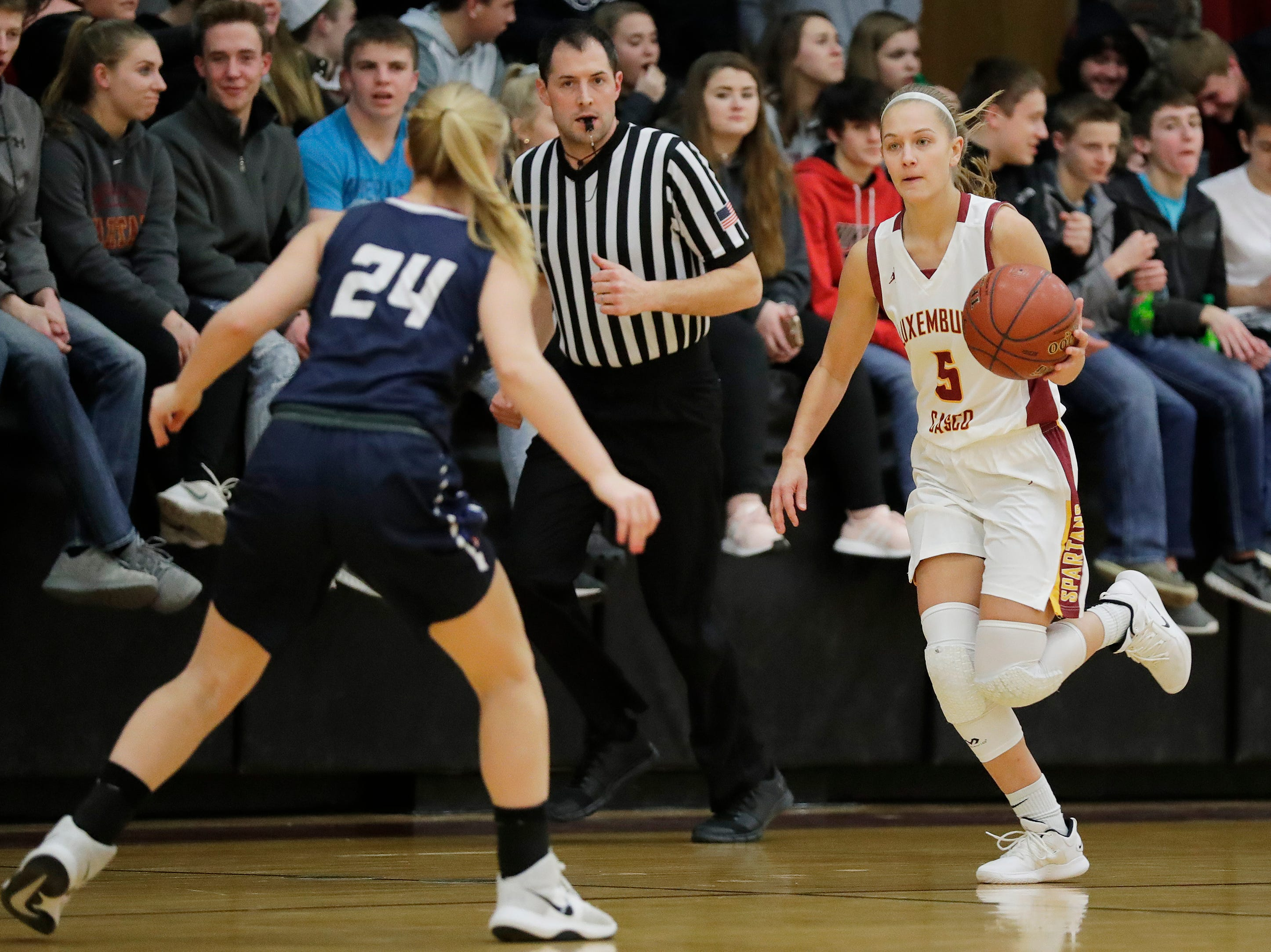 Luxemburg-Casco's Jenna Jorgensen (5) brings the ball up the court against Waupaca in a girls basketball game at Luxemburg-Casco high school on Thursday, January 10, 2019 in Luxemburg, Wis.